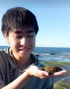 student holding sea slug